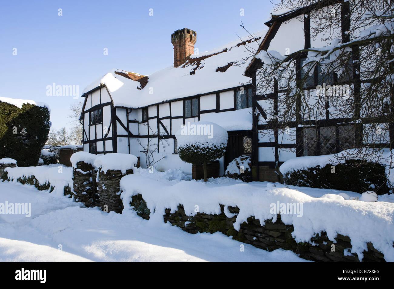 Cottage in Winter. Send, Surrey, UK. - Stock Image