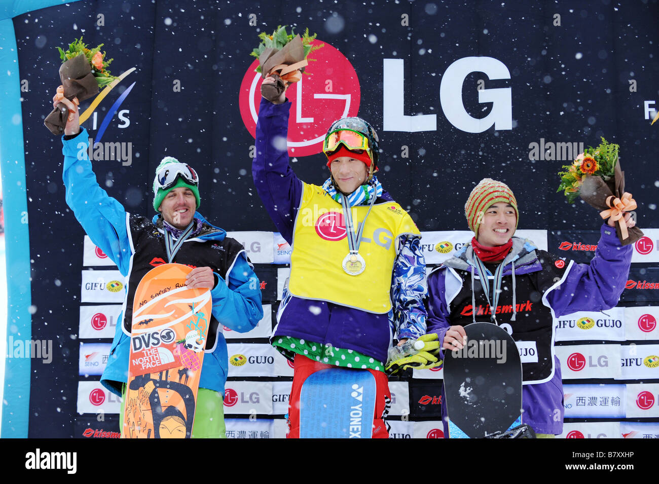 Ryo Aono JPN JANUARY 14 2009 Snowboarding Ryo Aono C of Japan celebrates 1st place on the podium with Ben Mates - Stock Image