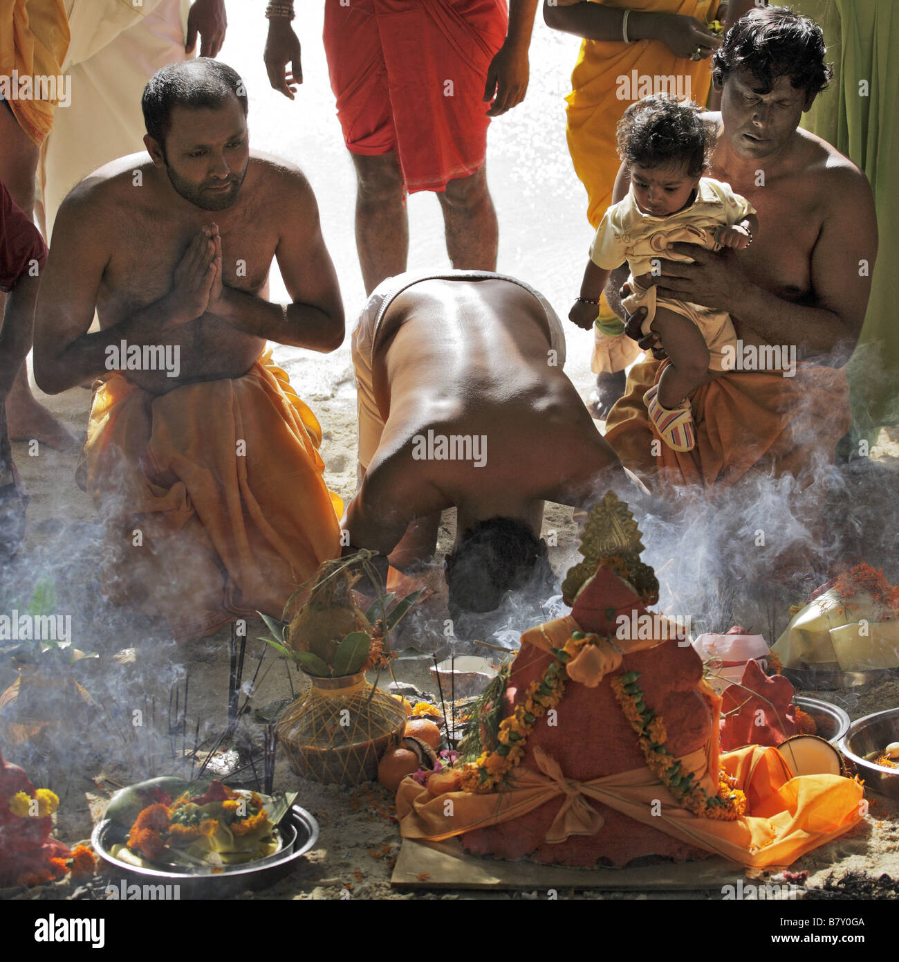 Men praying during Ganesh Chaturthi festival - Stock Image