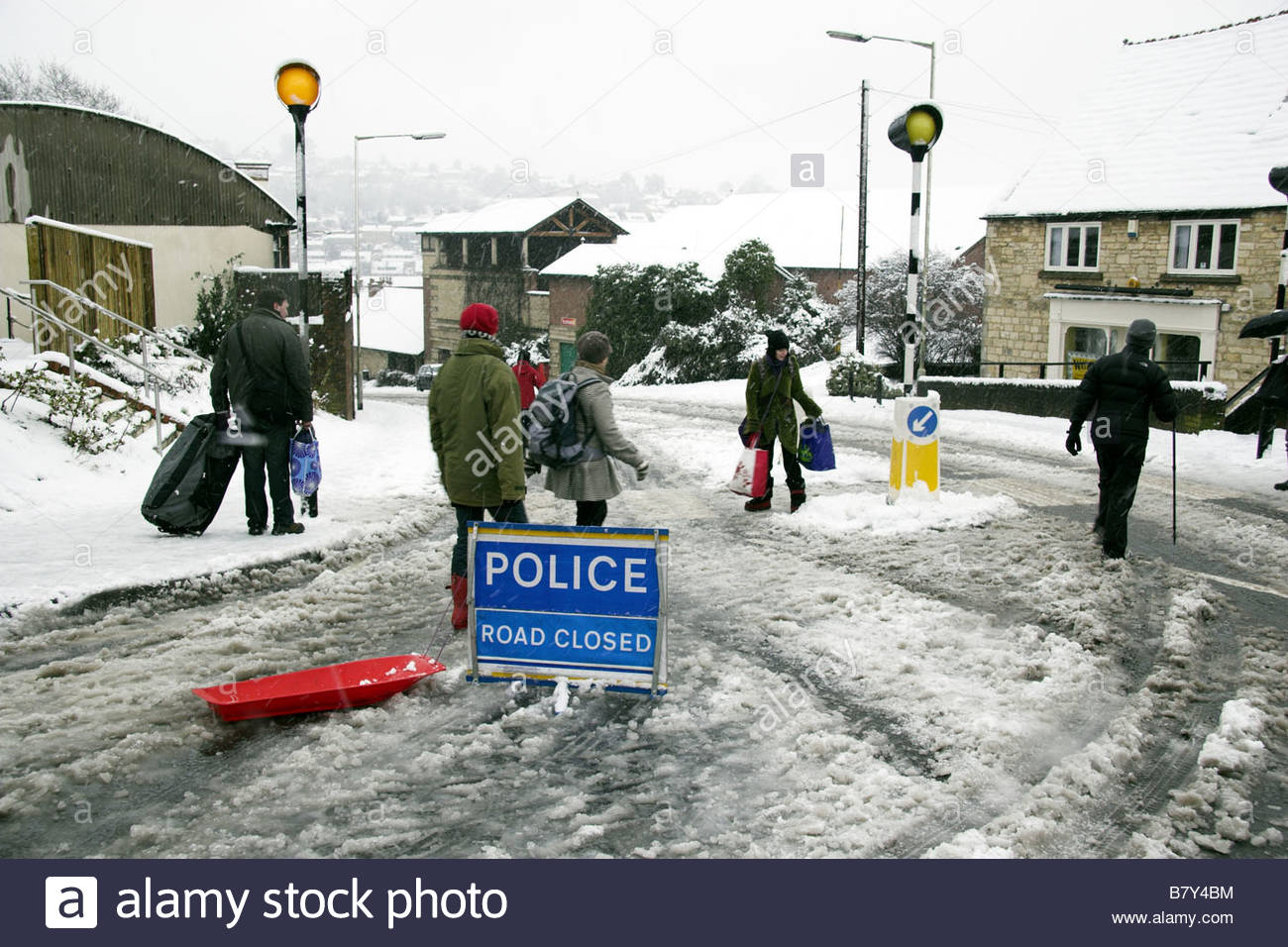 Snow disruption in Stroud - 'Police Road Closed' sign. UK - Stock Image
