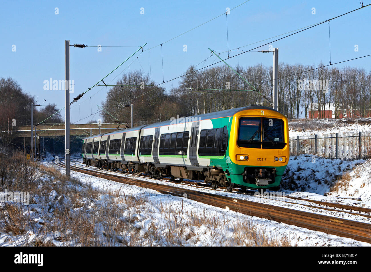 London Midland 323 217 passes through Sandwell Valley Park with the 10 13 Walsall Birmingham New Street service - Stock Image