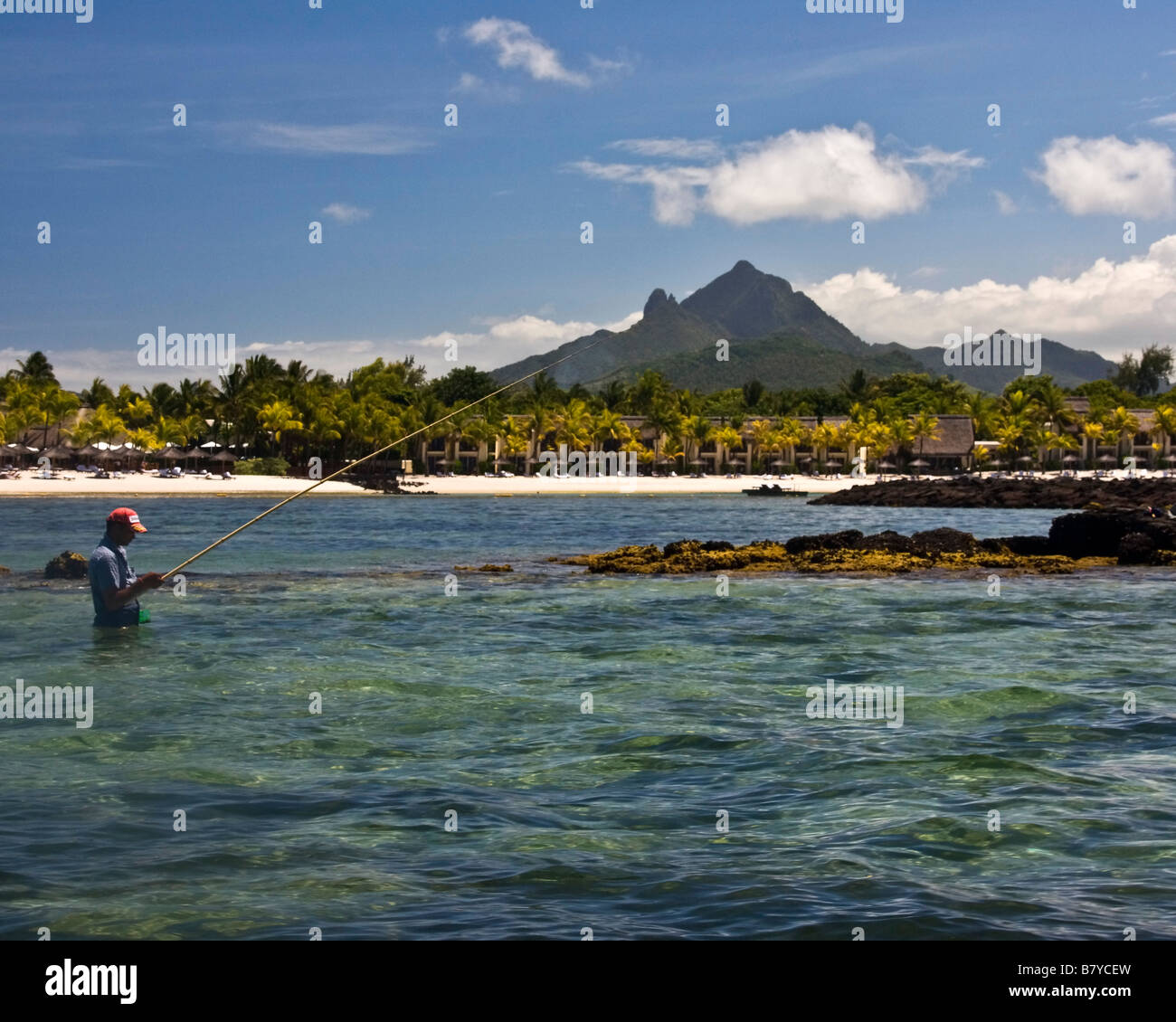 Fisherman background Villas waterfront of five star Hotel Le Touessrok in Trou d Eau Douce Mauritius Africa - Stock Image