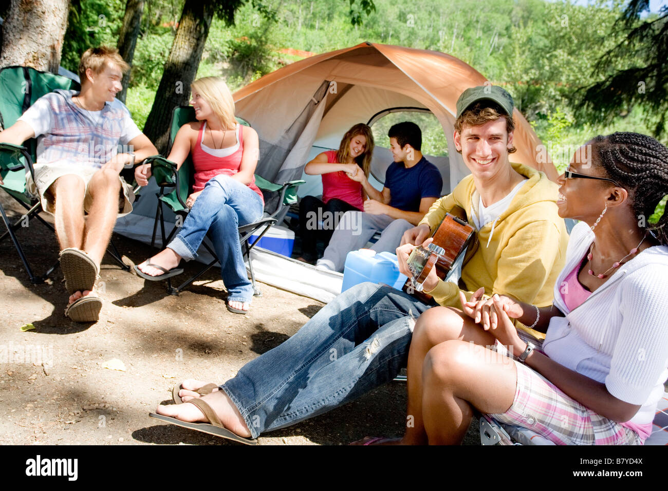 Group of young people at a campsite - Stock Image
