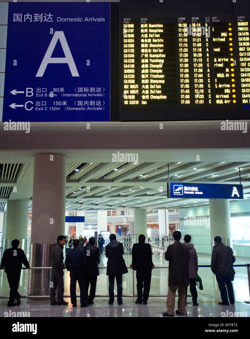 Domestic Arrivals flight information electronic display board at new Beijing Airport Terminal 3 China 2009 - Stock Image