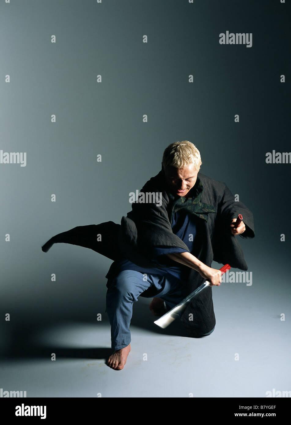 Takeshi Kitano Takeshi Kitano Takeshi Kitano sur le tournage on the set The Blind Swordsman: Zatoichi / Zatôichi - Stock Image