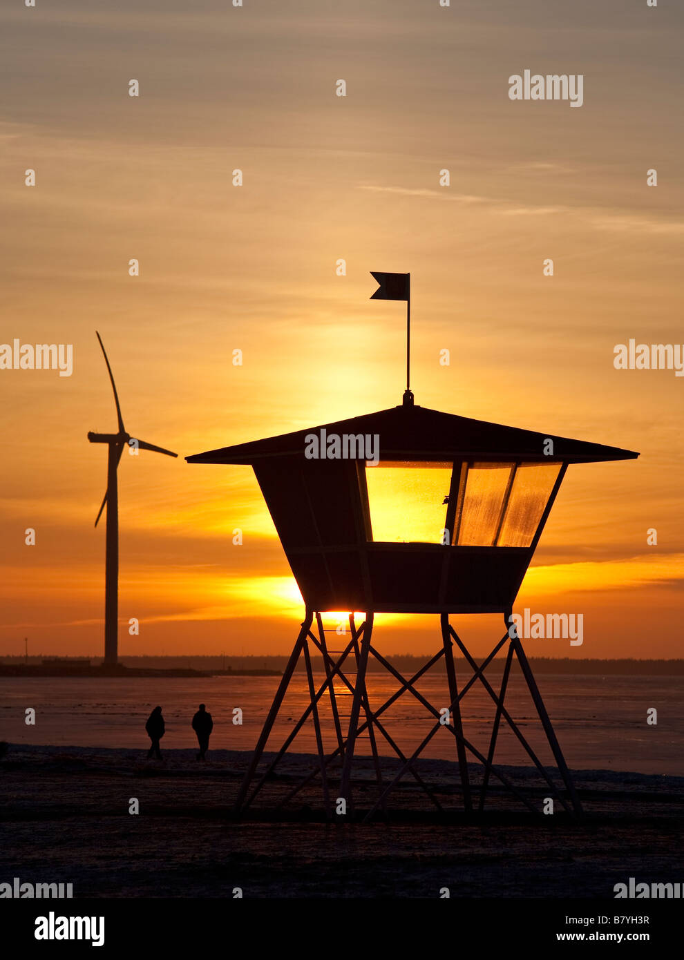 Wind turbine and lifeguard's watchtower at seashore , Finland - Stock Image