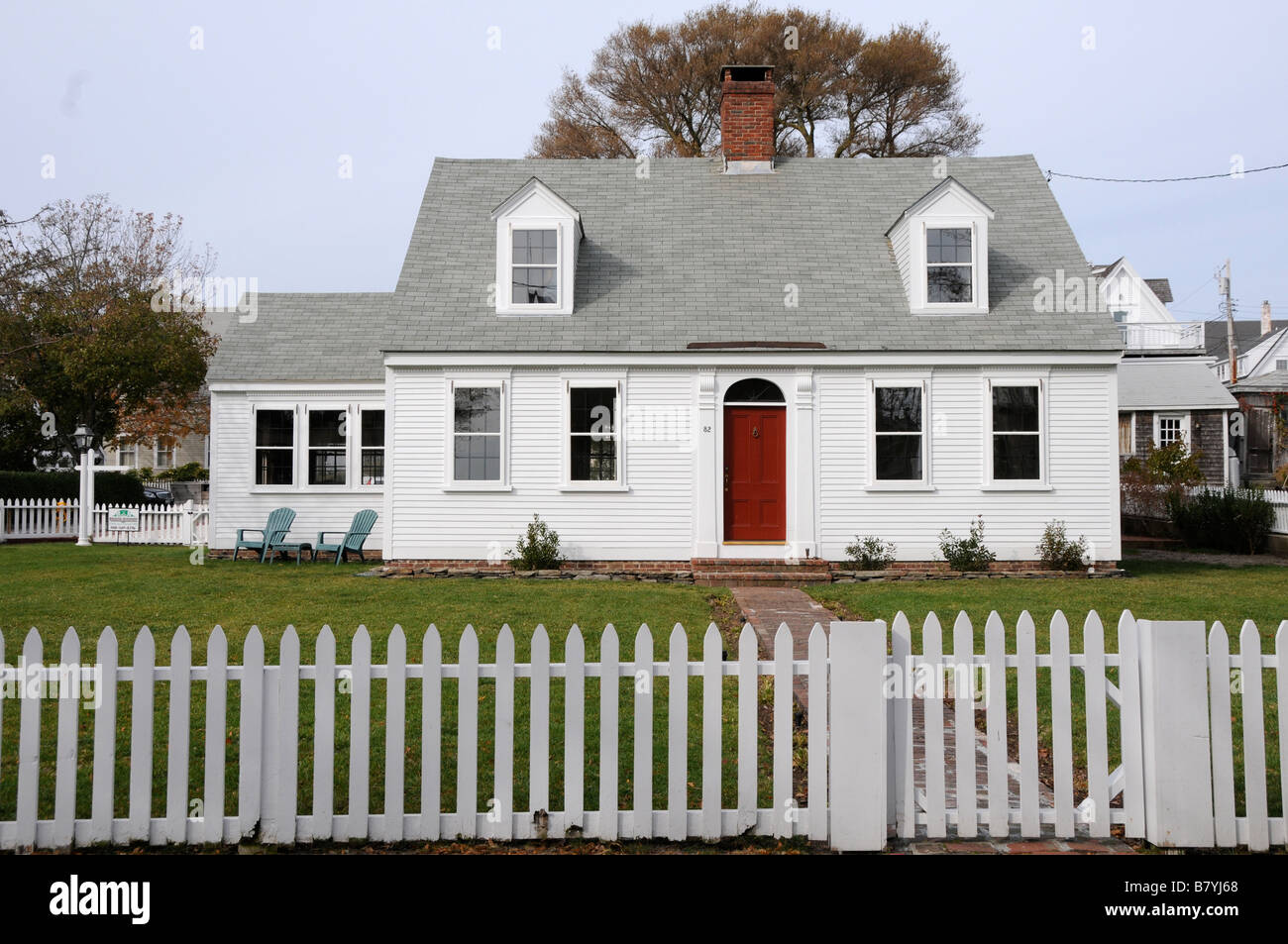 Traditional New England Home With White Picket Fence Stock Photo