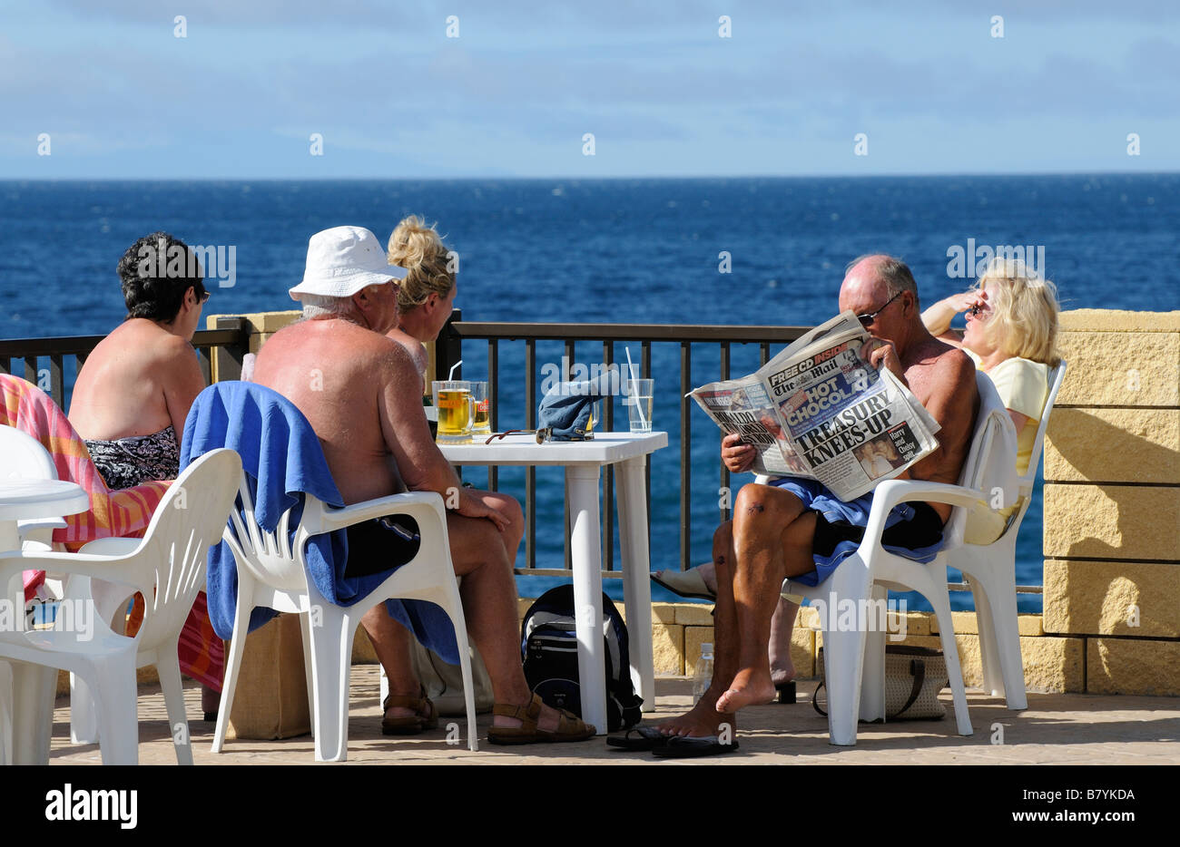 Holidaymakers enjoying the warm sunny climate of Los Gigantes Tenerife Canary Islands - Stock Image
