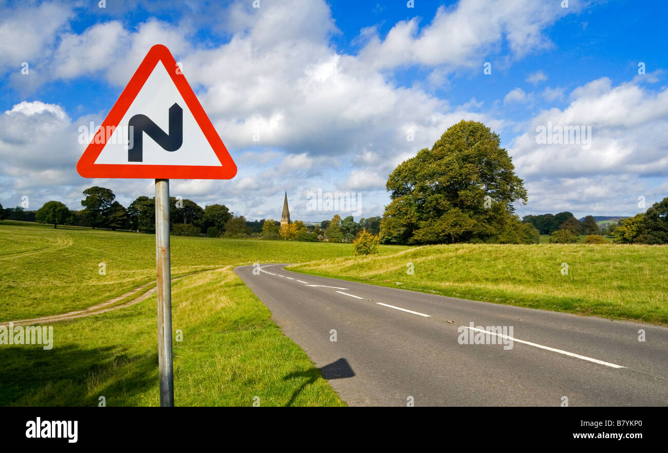 Triangular double bend warning sign on a country road - Stock Image