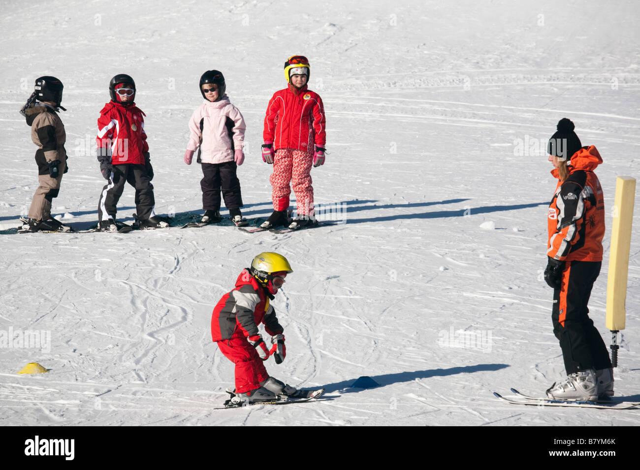 Rauris Austria Europe.  Children learning on ski school nursery slopes on winter snow - Stock Image