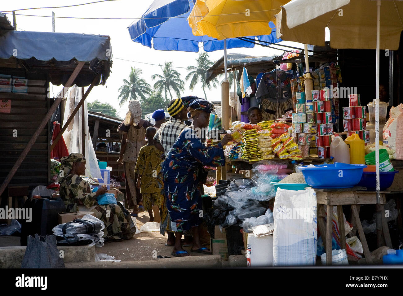 People shopping in a local market in Poka Epe Nigeria - Stock Image
