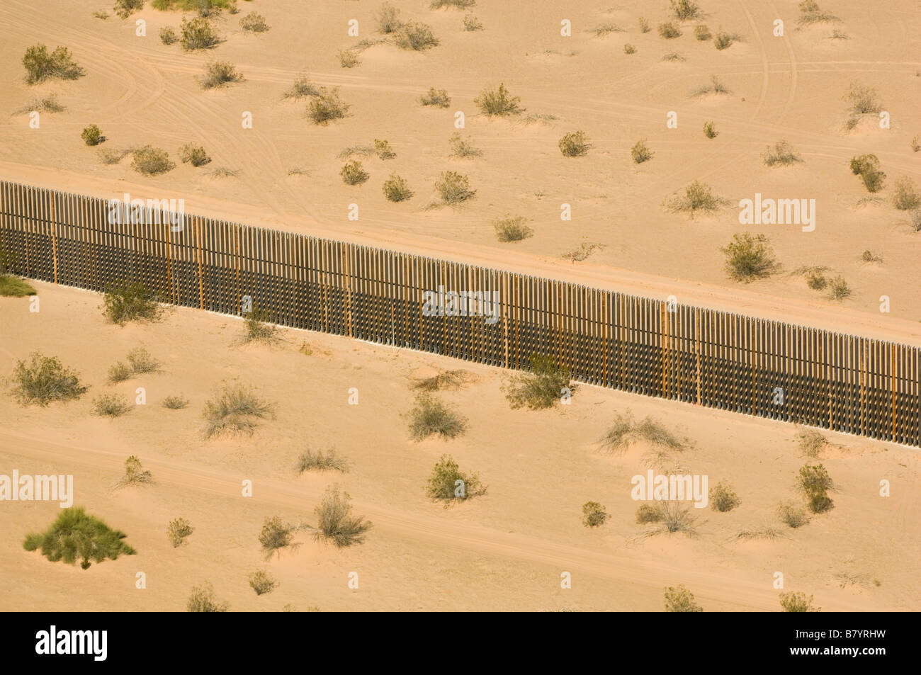 US Mexico Border fence, AERIAL, Imperial Dunes near Calexico, California - Stock Image