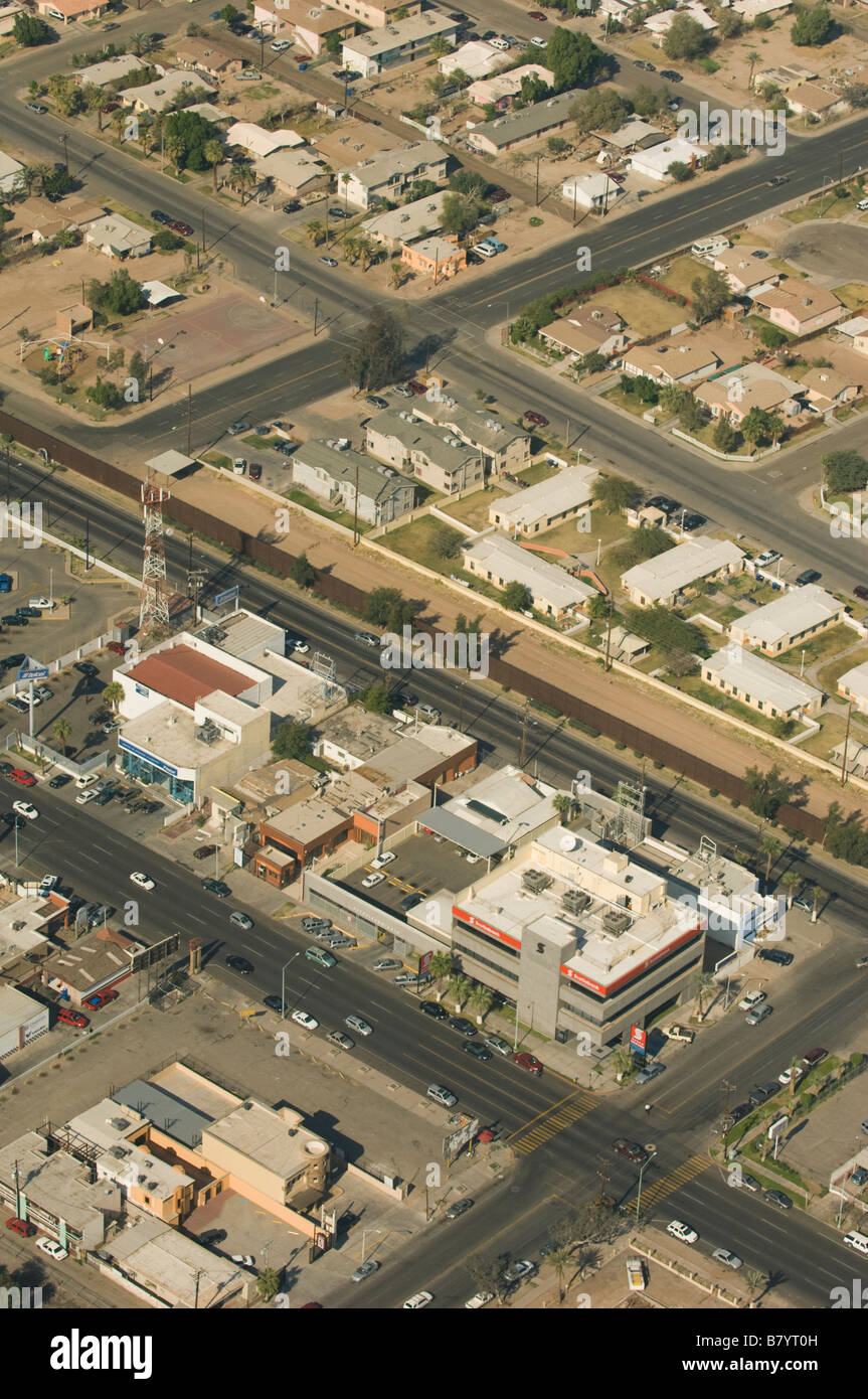 US Mexico Border Fence divides Calexico, California and Mexicali, Mexico AERIAL - Stock Image