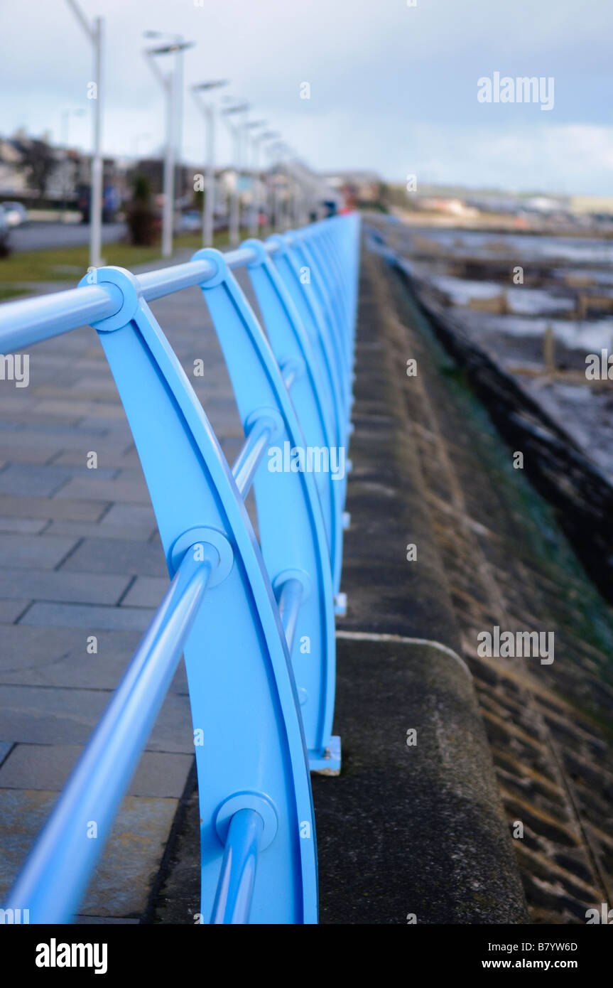 Blue iron railings along sea front at Carrickfergus - Stock Image