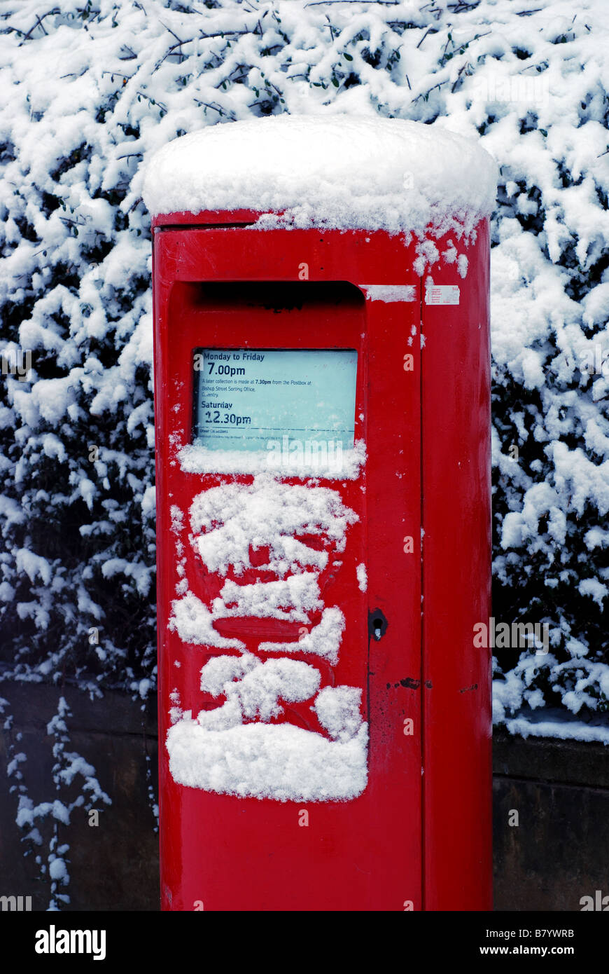 Two red type-K postboxes in snow, UK - Stock Image