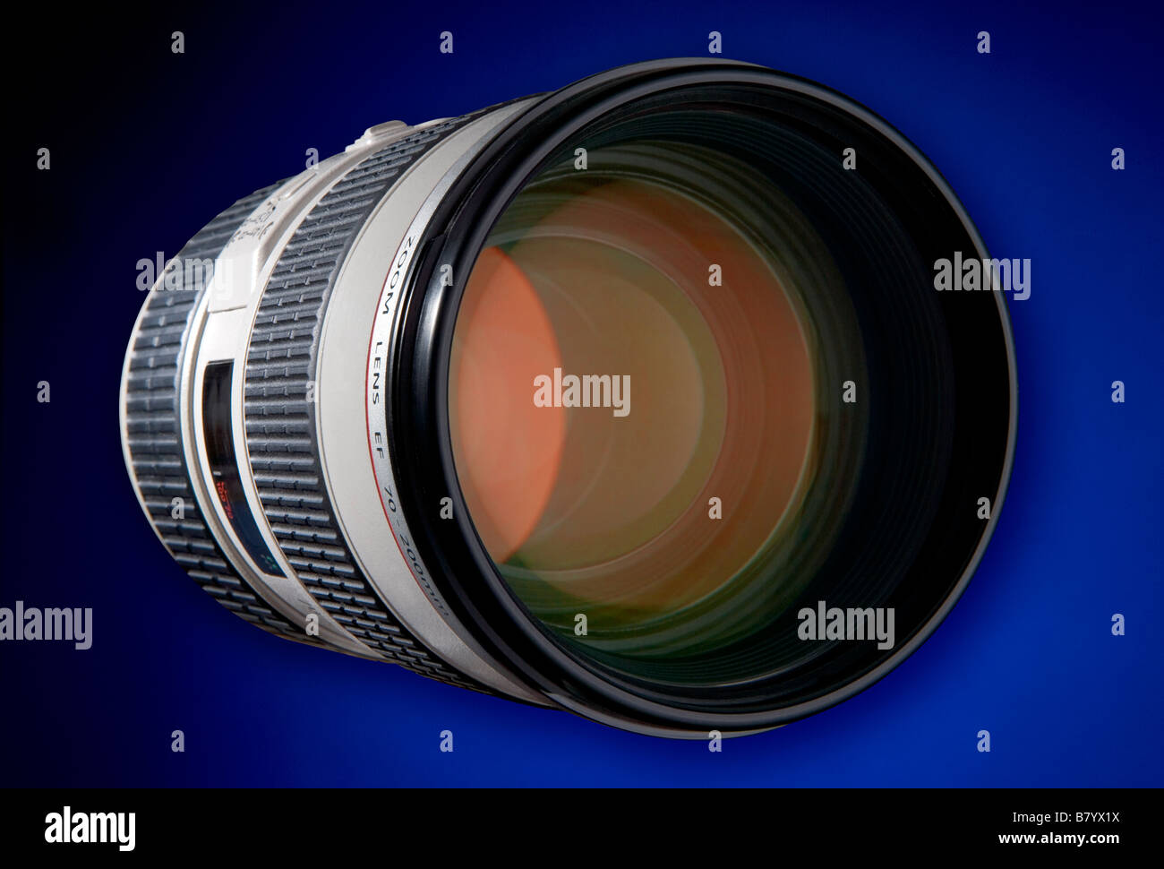 A white body lens with ruby red coatings on the front elements This one os an 80 200 zoom from an SLR digital camera - Stock Image