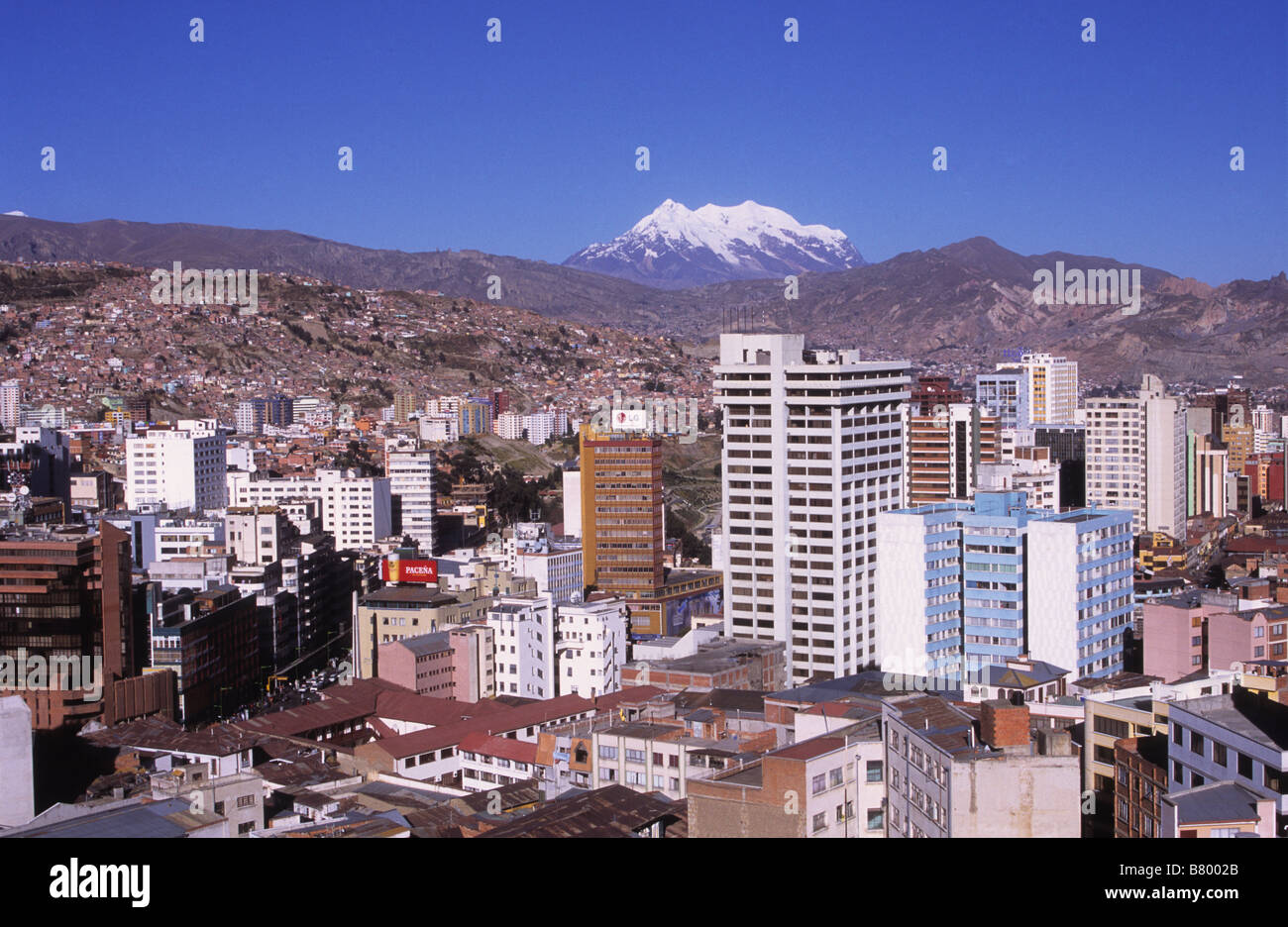 High rise apartment buildings in central La Paz and Mt Illimani, Bolivia - Stock Image