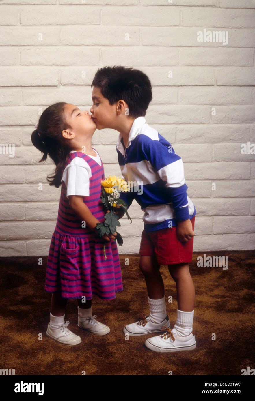 Hispanic Brother And Sister Kiss Love Sibling Stock Photo 22128677