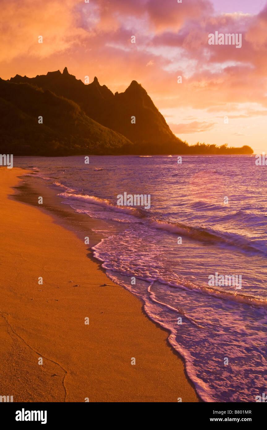 Evening light on Na Pali Coast spires from Tunnels Beach Island of Kauai Hawaii - Stock Image
