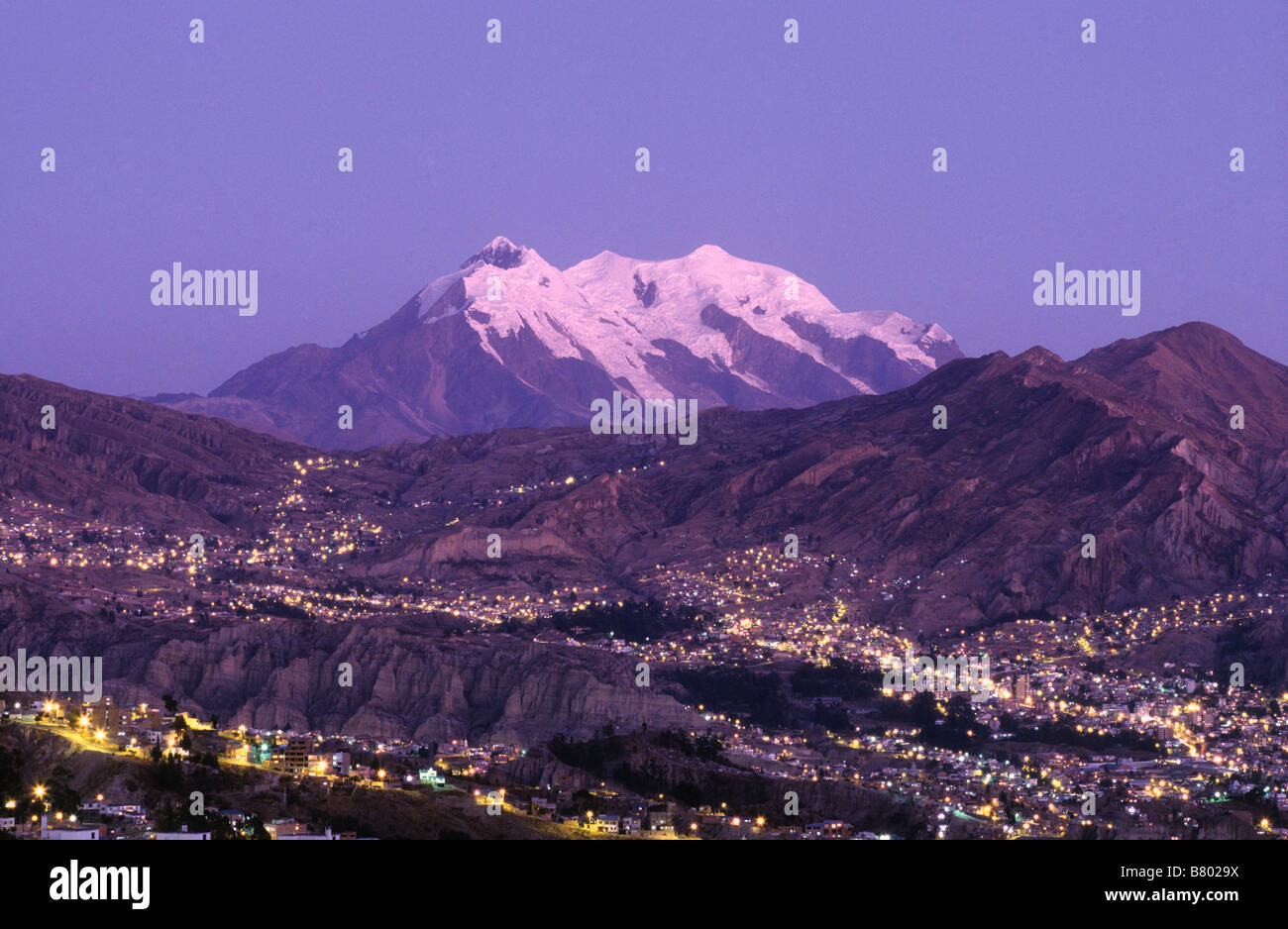 Lights of Zona Sur and Mt Illimani at sunset, La Paz, Bolivia - Stock Image