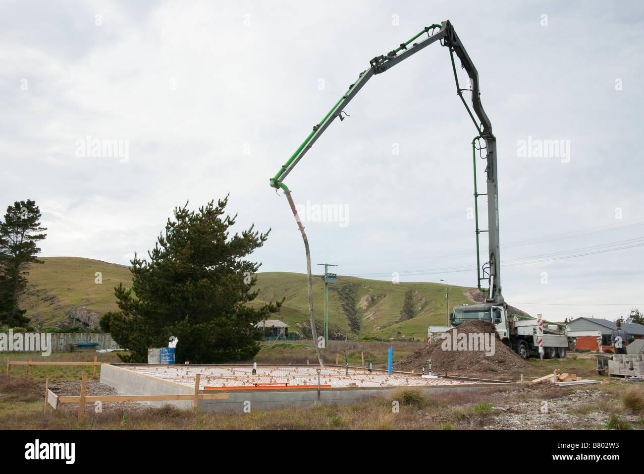 Concrete pump ready to pour foundation slab Stock Photo
