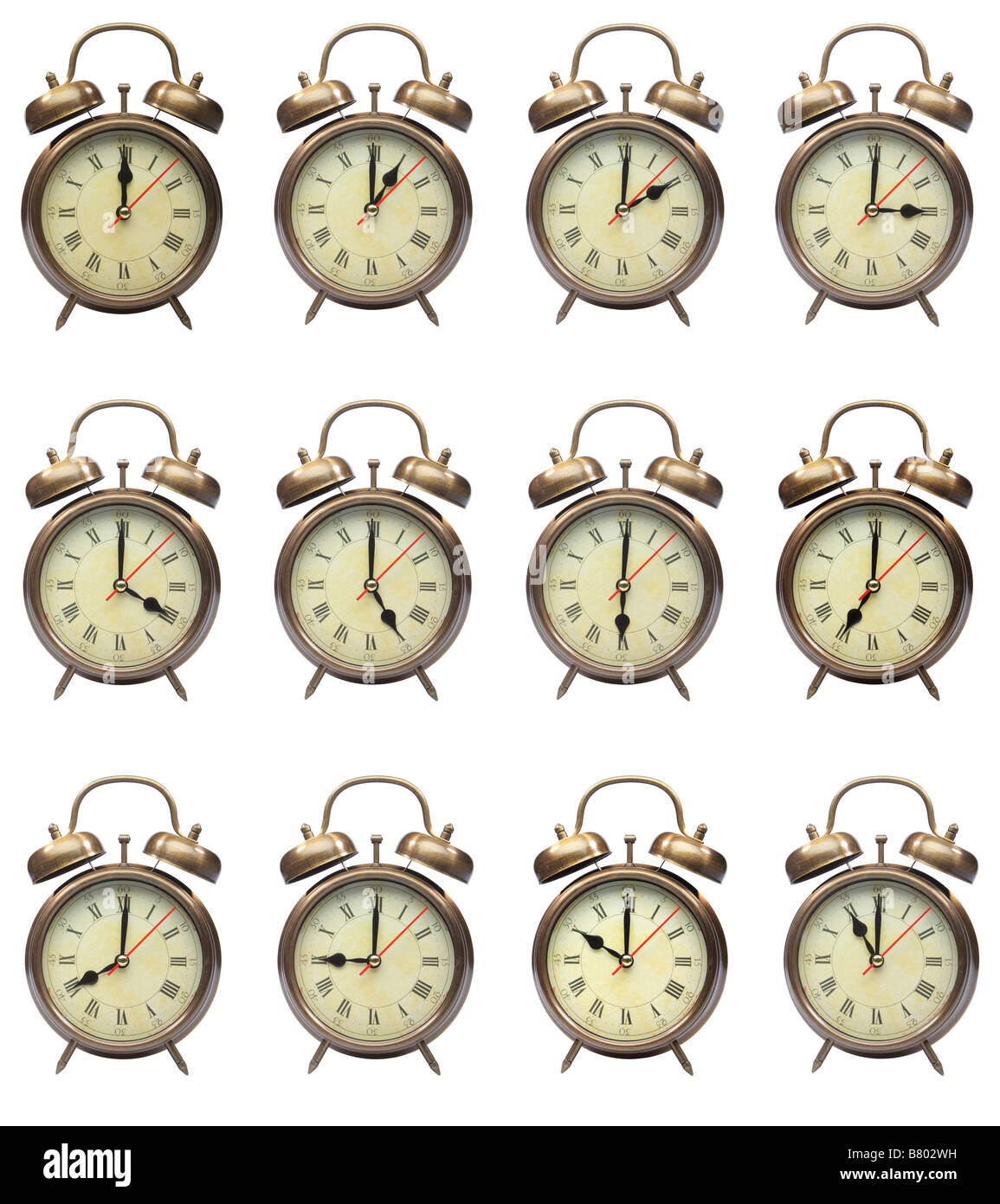 vintage alarm clocks isolated on white showing 24 hours of the day - Stock Image