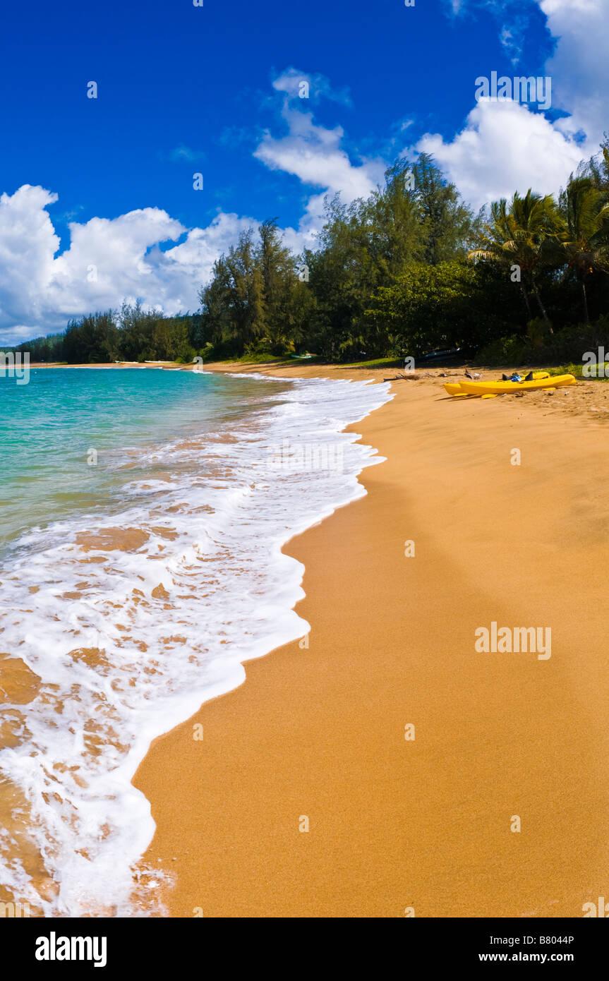 Kayaks on empty beach at Hanalei Bay Island of Kauai Hawaii - Stock Image