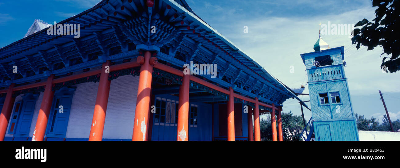Low angle panoramic shot of the wooden Dungan mosque located in the heart of Karakol, Kyrgyzstan. - Stock Image