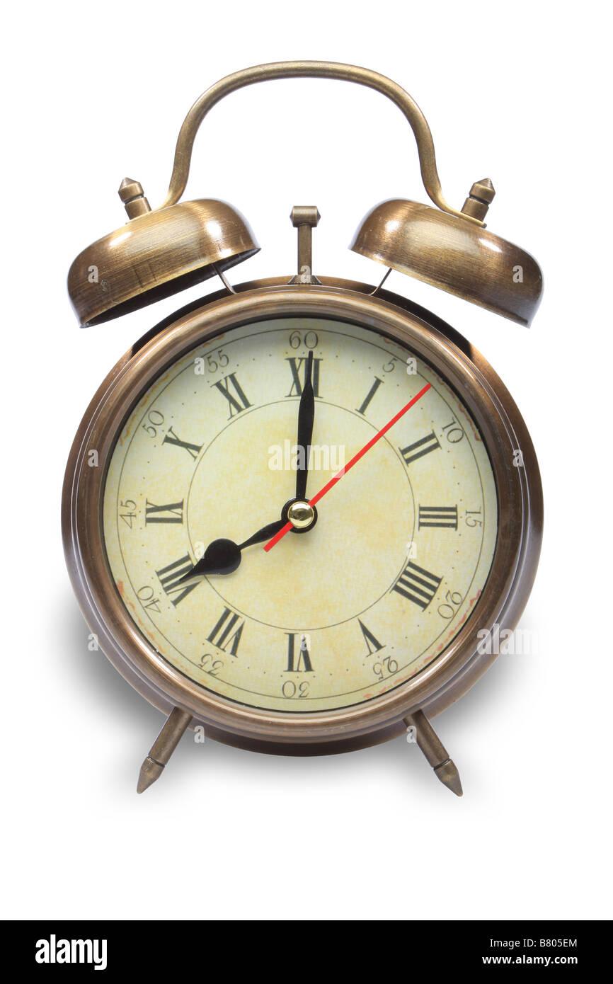 vintage bronse alarm clock isolated on white - Stock Image
