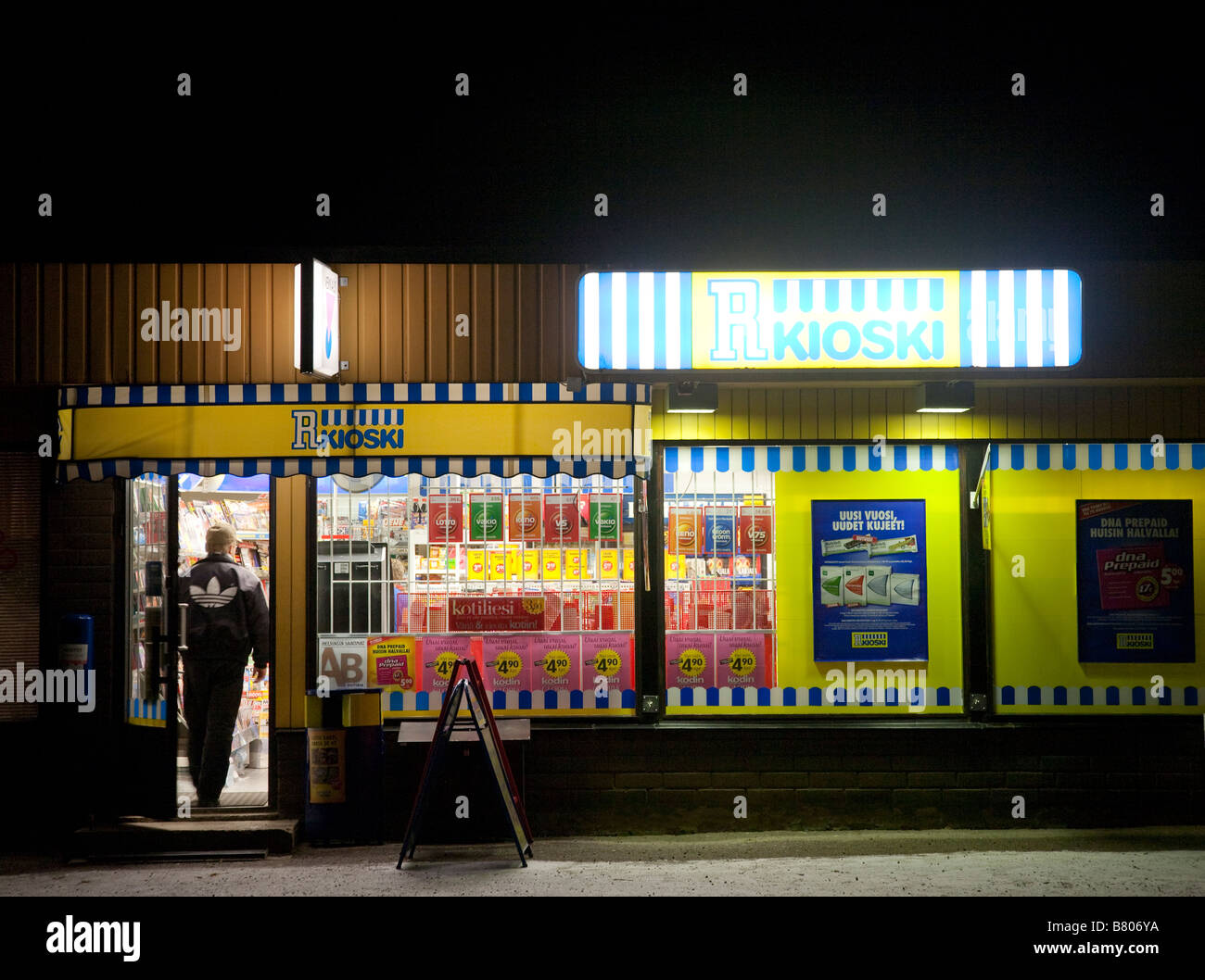 Customer entering Finnish kiosk at nighttime , Finland - Stock Image