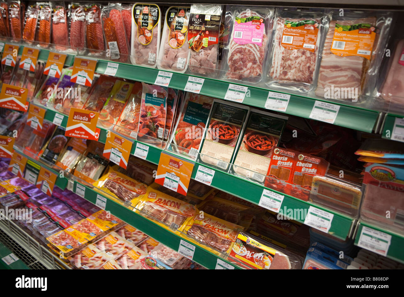 Meat in plastic packets Spain - Stock Image