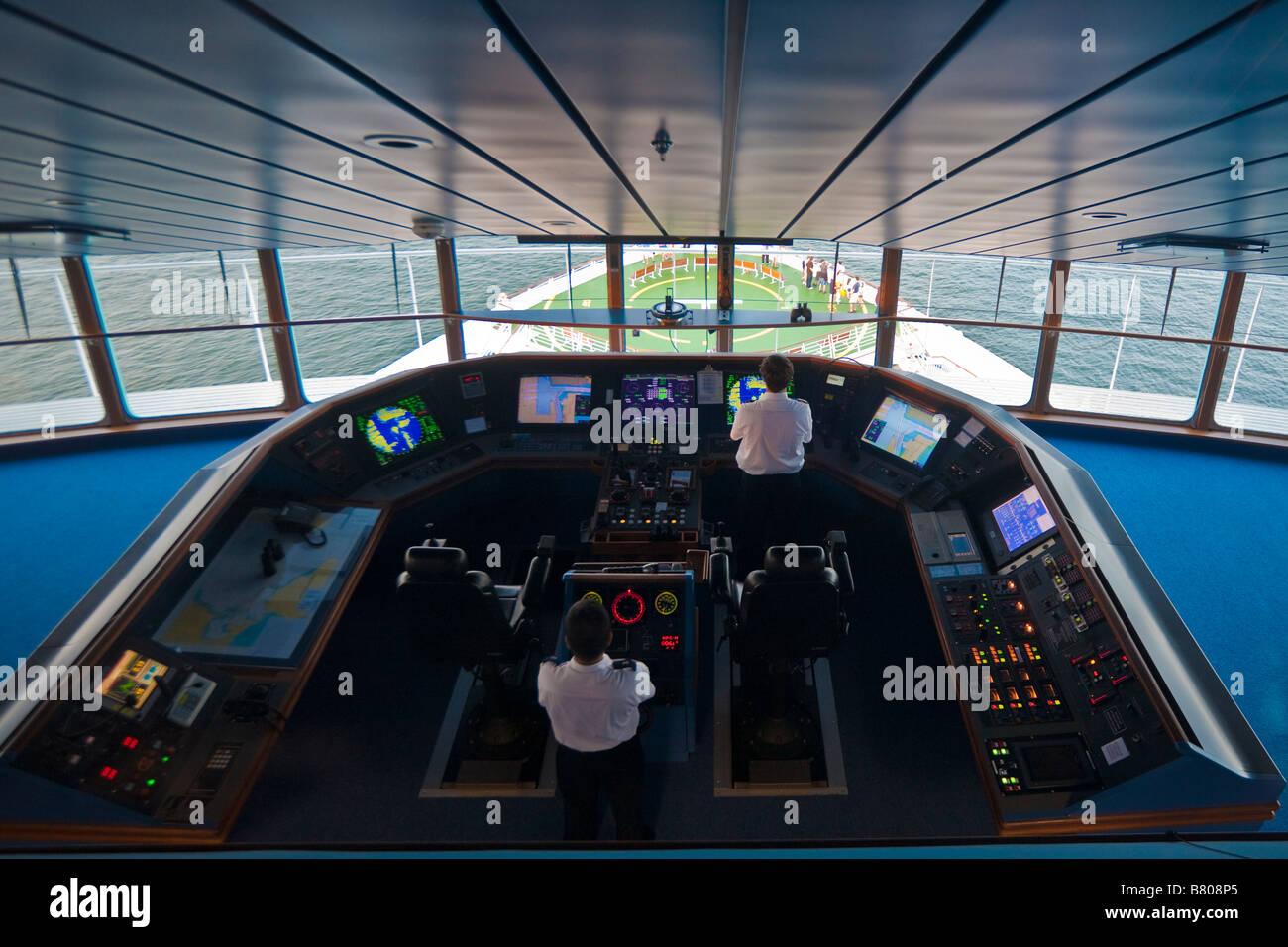Crew members in the Bridge of Royal Caribbean's Navigator of the Seas cruise ship - Stock Image
