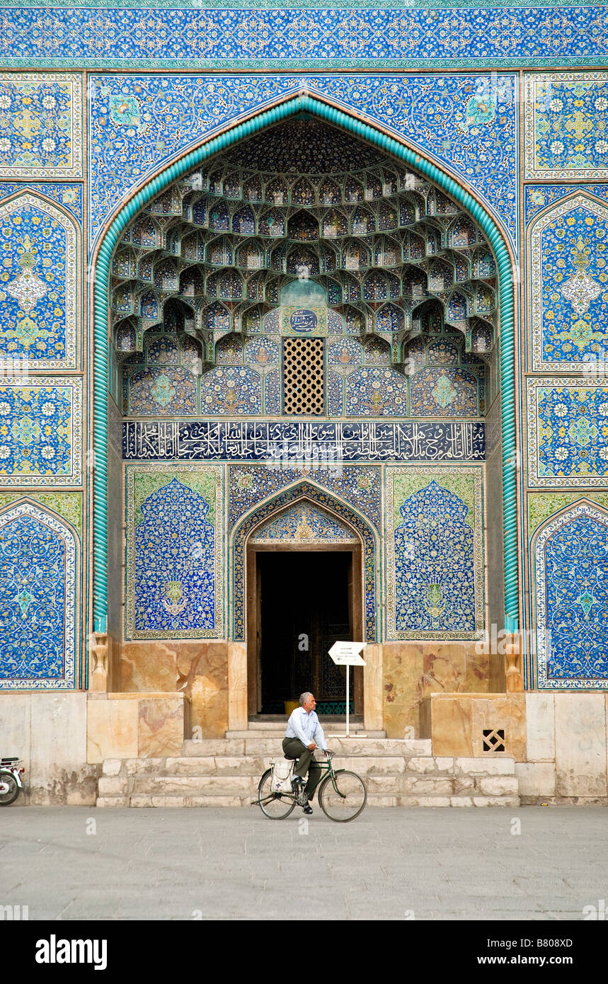 man cycling by mosque door isfahan esfahan iran - Stock Image
