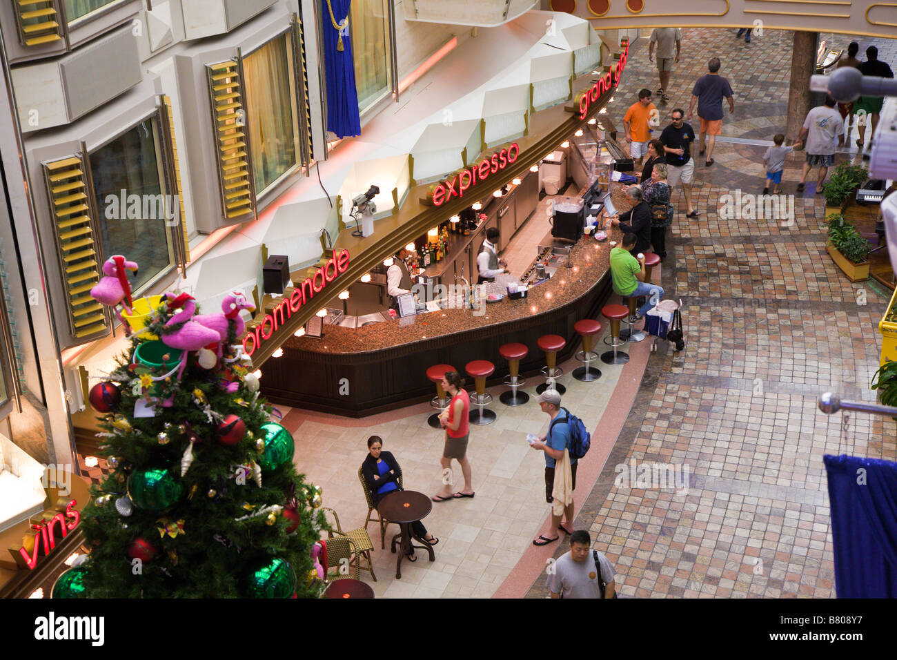 Christmas tree in Royal Promenade deck of Royal Caribbean Navigator of the Seas cruise ship - Stock Image