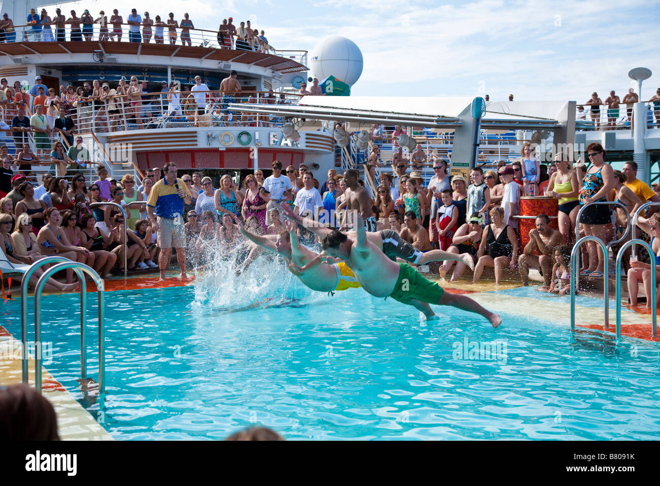Belly flop contest on the deck of Royal Caribbean Navigator of the Seas cruise ship - Stock Image