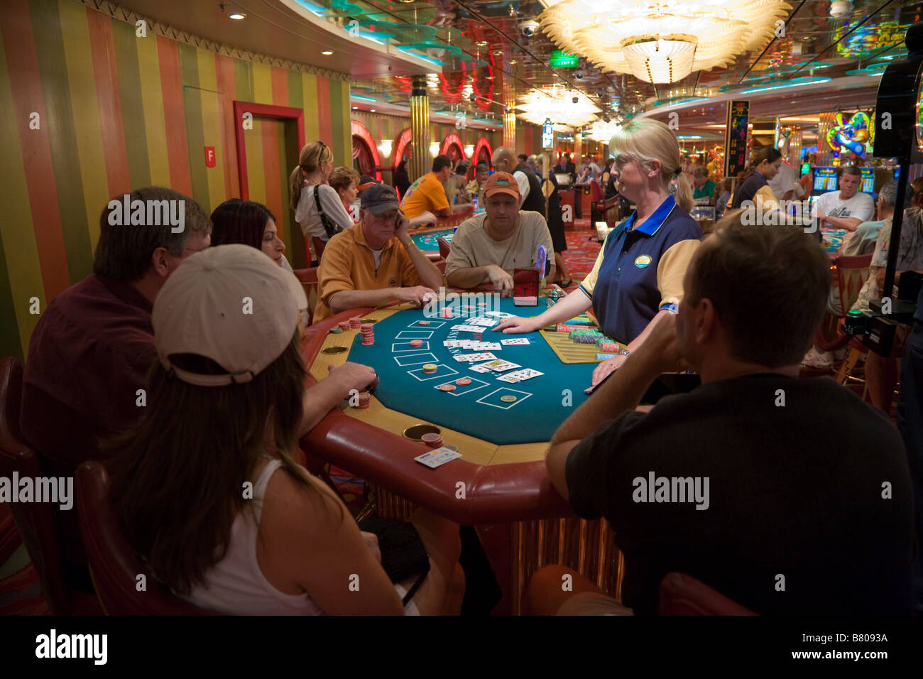 People playing black jack in casino on Royal Caribbean Navigator of the Seas cruise ship - Stock Image