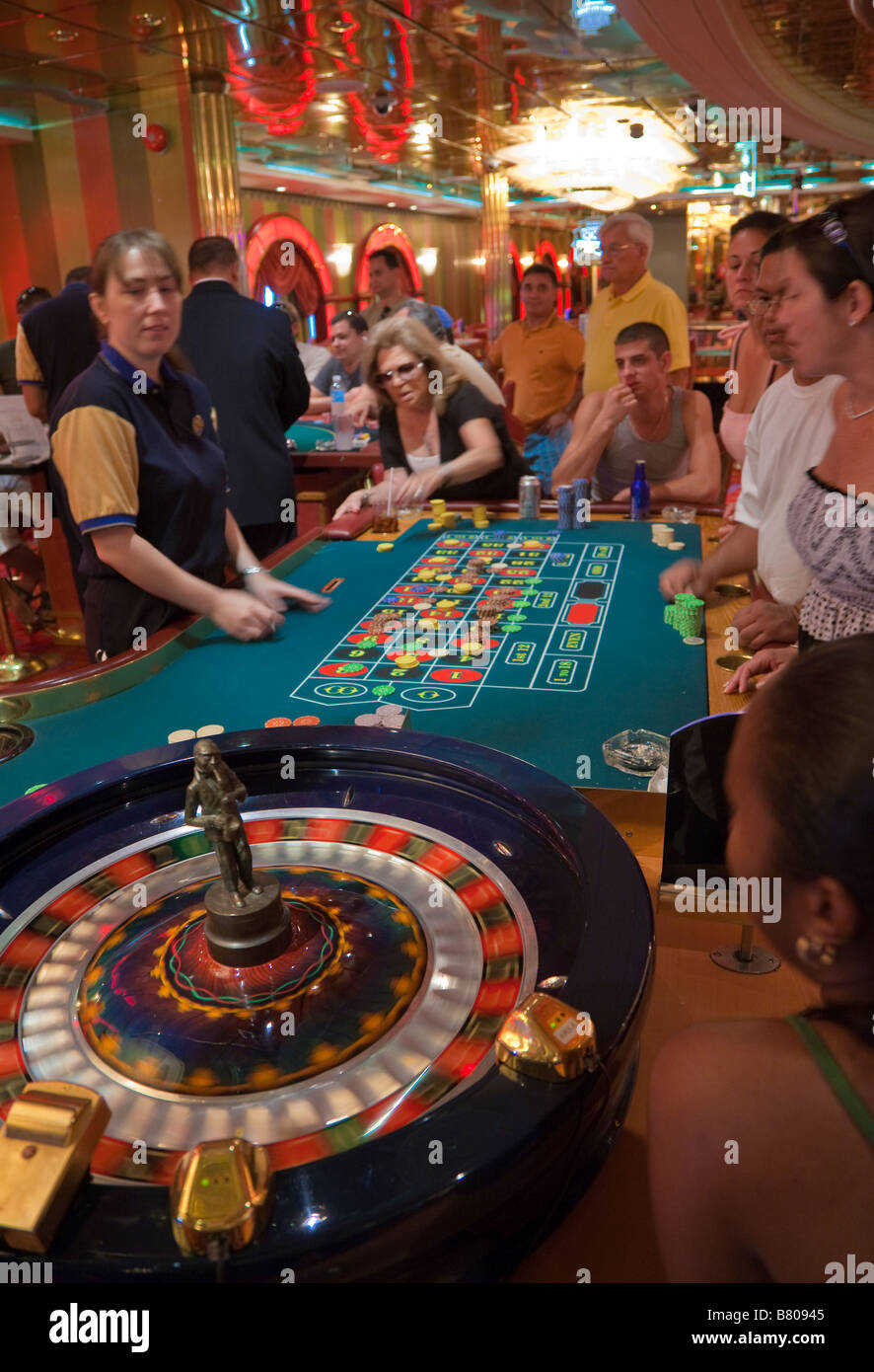 Gamblers playing roulette in casino on Royal Caribbean Navigator of the Seas cruise ship - Stock Image