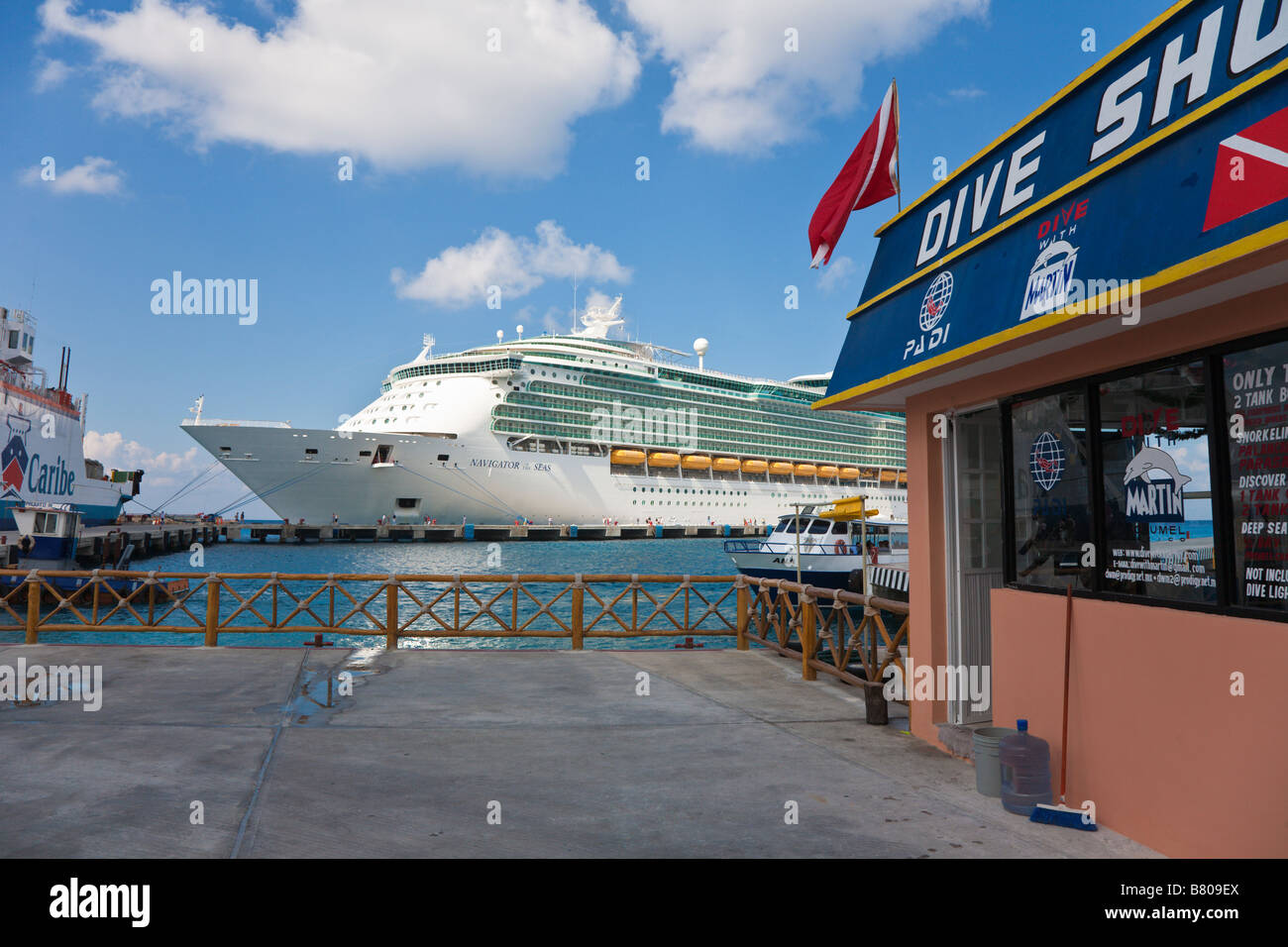 Royal Caribbean Navigator of the Seas cruise ship docked at the port of Cozumel, Mexico accross from dive shop - Stock Image