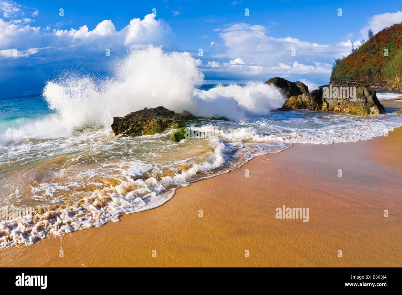 Crashing waves and rocks at Hanakapi ai Beach Na Pali Coast Island of Kauai Hawaii - Stock Image
