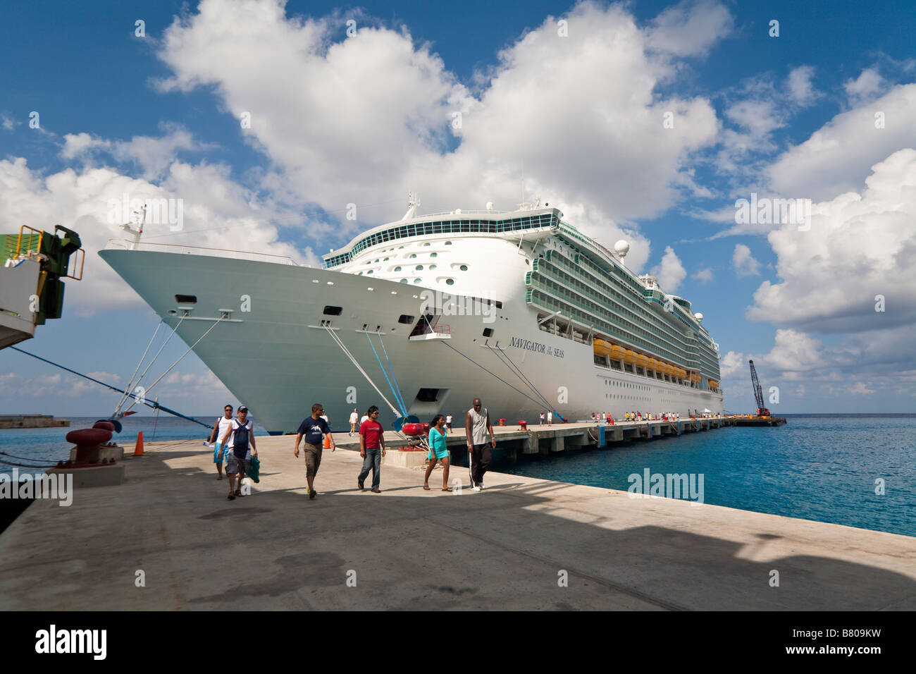 Passengers disembark from Royal Caribbean Navigator of the Seas cruise ship docked at port in Cozumel, Mexico - Stock Image