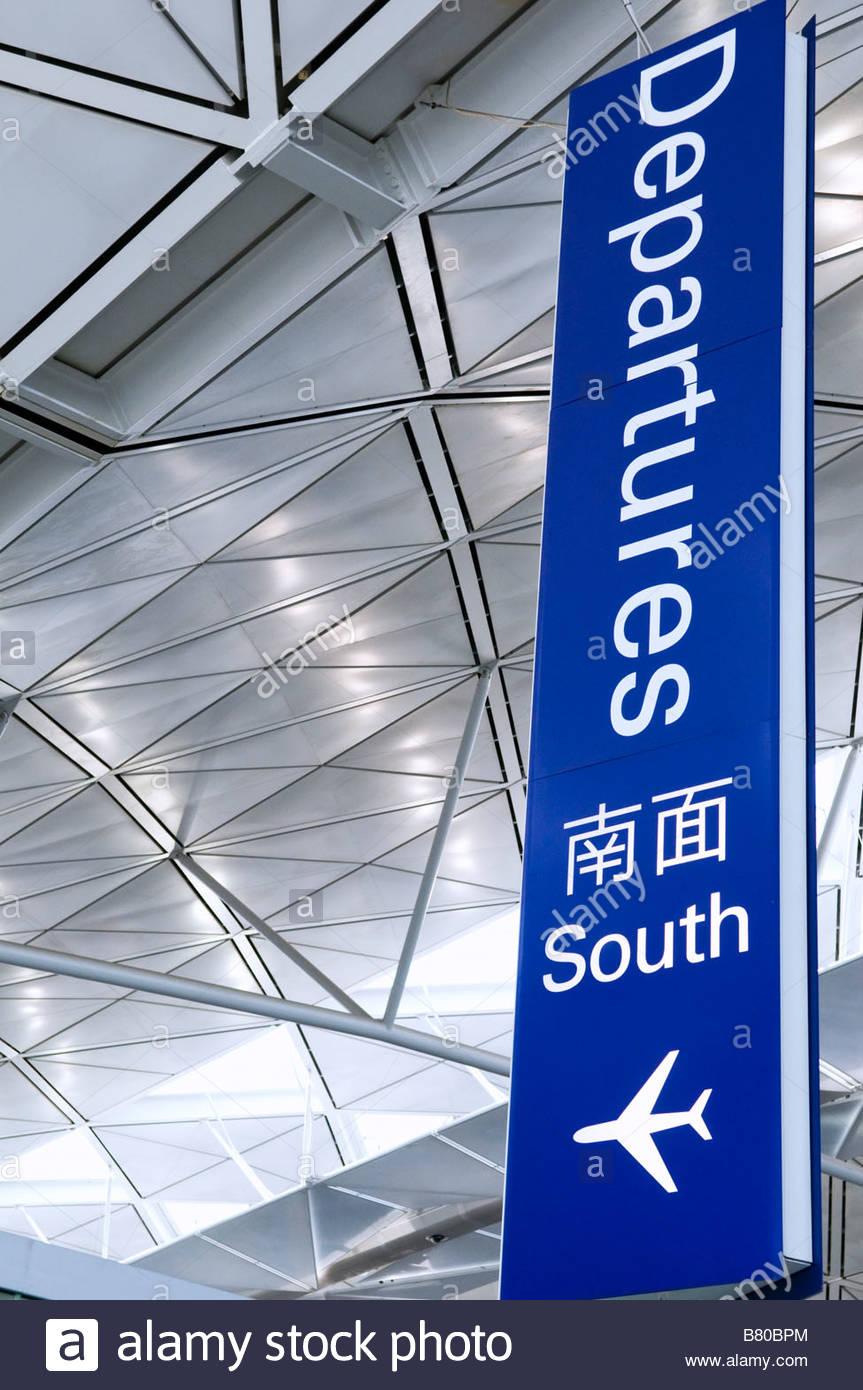 Departures sign at  Hong Kong Chek Lap Kok Airport - Stock Image