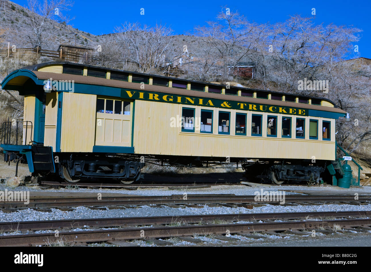 A rail car for the Virginia and Truckee Railroad sits on tracks in Virginia City Nevada - Stock Image