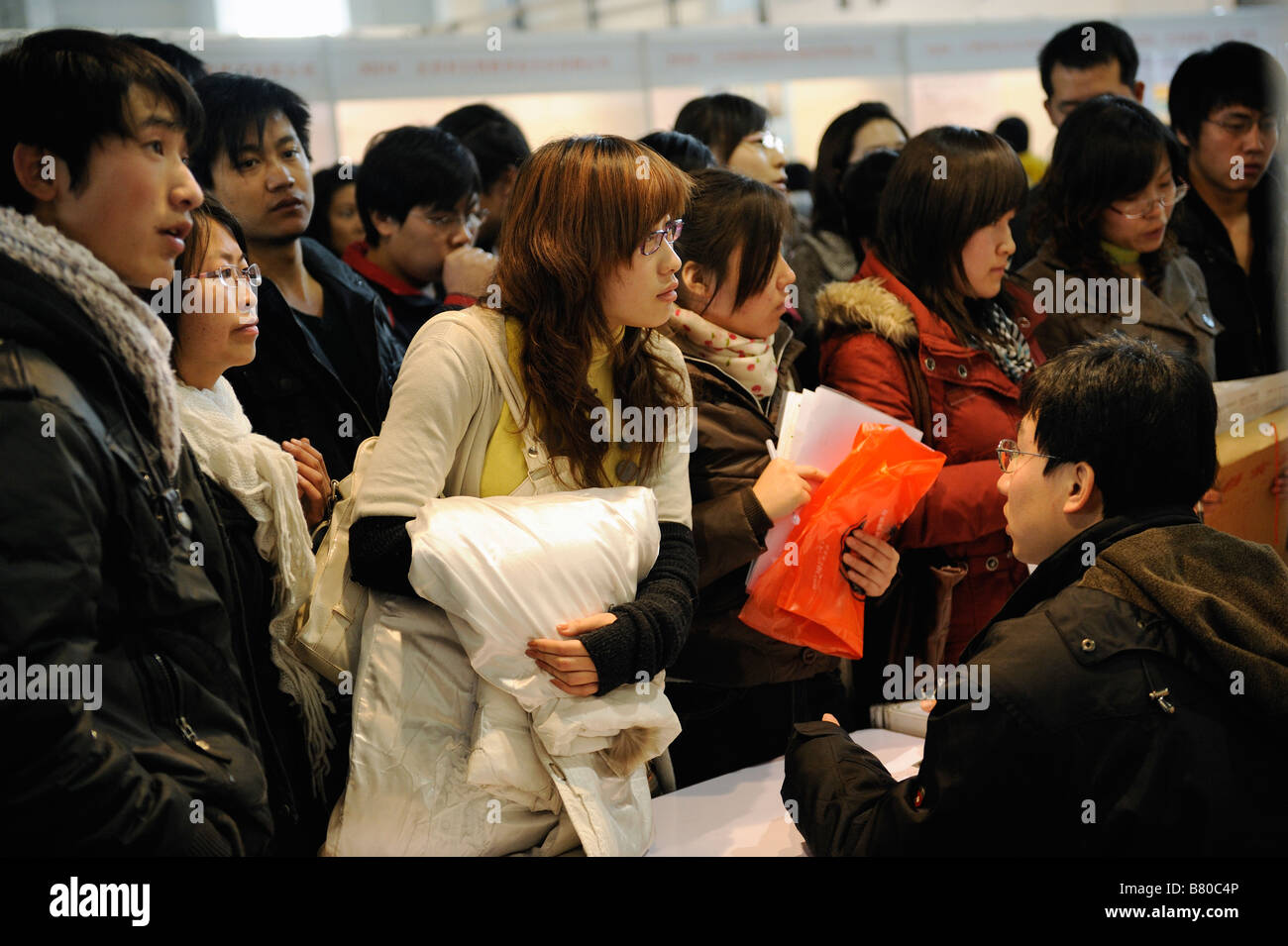 Job seekers try to find a work at a job fair in Beijing on February 8, 2009 - Stock Image