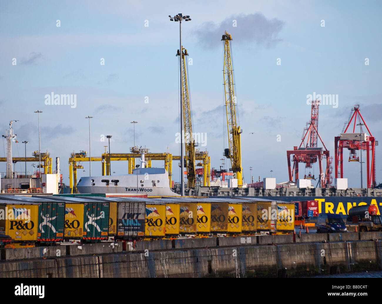 containers and container ship at dock in Dublin harbor, Ireland - Stock Image