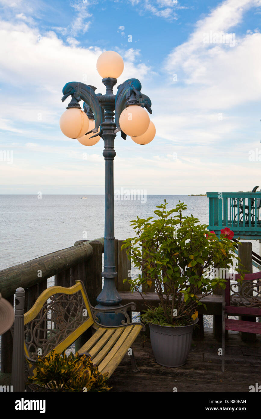 Dolphin Shaped Lamp Post On Patio Overlooking The Gulf Of Mexico At Coastal  Restaurant In Cedar Key, Florida, USA