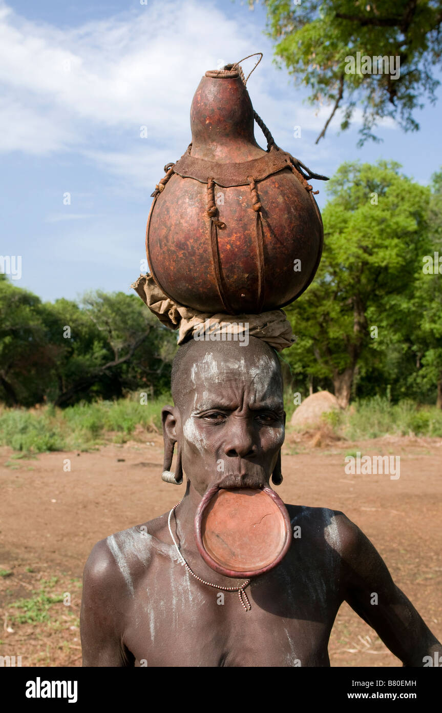 Mursi women with plate in her lips Mago National Park Omovalley Ethiopia Africa - Stock Image