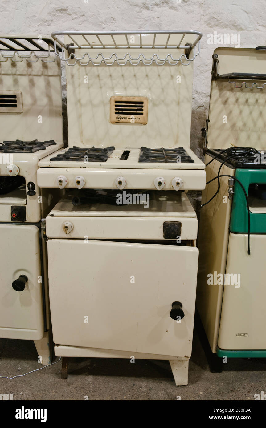 Old gas cookers from the 1950s, 1960s and 1970s lined up in Flame Gasworks Museum of Ireland. - Stock Image