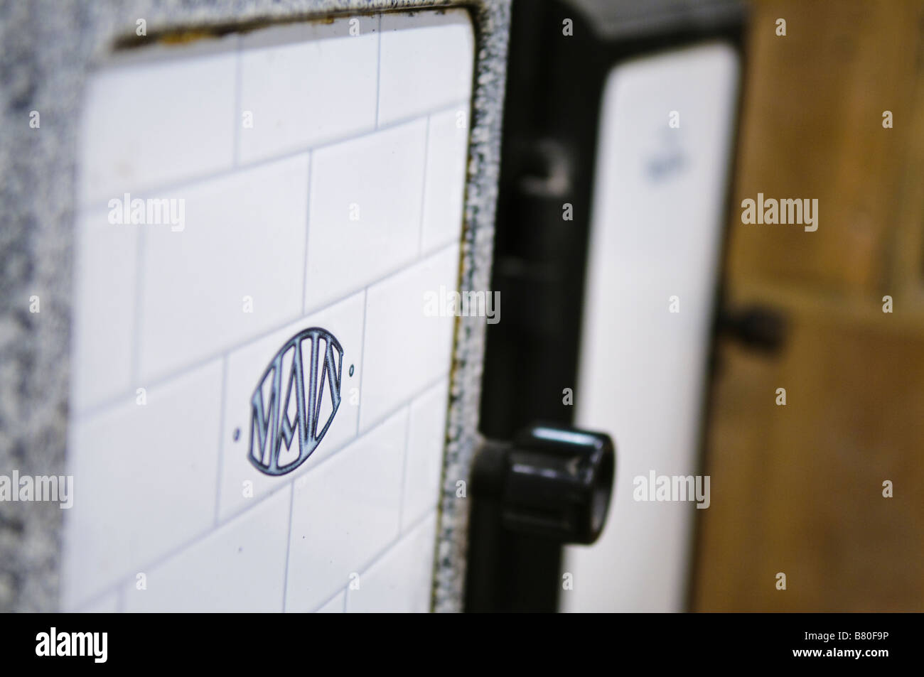 Oven door of a cast iron 'Main' gas cooker from c1900-1920. - Stock Image