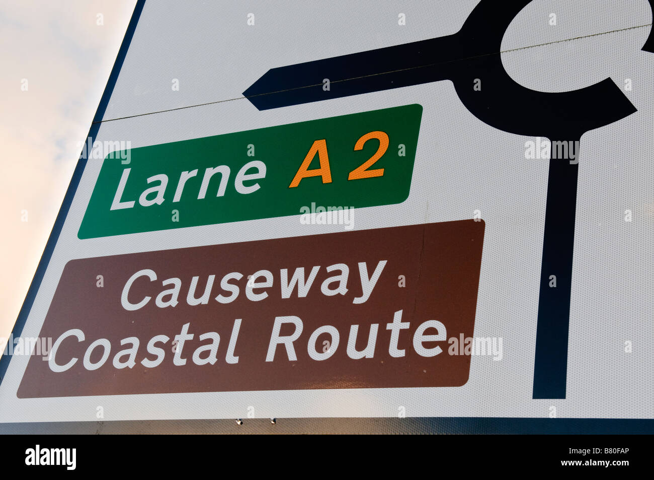 Direction road sign indicating the 'Causeway Coastal Route', or the Coast Road around County Antrim to the - Stock Image