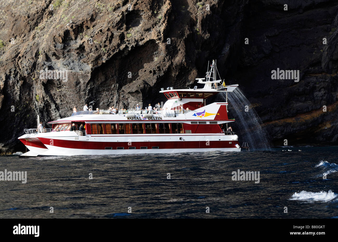 The Royal Delfin tourist boat trip of the Los Gigantes cliffs in the Atlantic Ocean of Tenerife Canary Islands - Stock Image